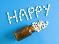 Word happy and jar pills Royalty Free Stock Photos
