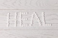 Word heal made of pills on table white wooden Royalty Free Stock Photos