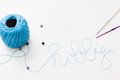 Word hobby made of blue thread, beads and crochets Royalty Free Stock Photo