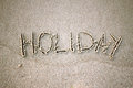 The word holiday in the sand Stock Photography