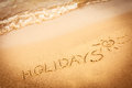 The Word Holidays Written In T...