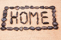 Word home written with pebbles on the sand Royalty Free Stock Photo