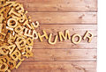Word humor made with wooden letters block next to a pile of other over the board surface composition Royalty Free Stock Photography