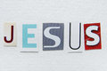 Word jesus cut newspaper white handmade paper texture Royalty Free Stock Photos