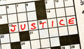 The Word Justice on Crossword Puzzle Royalty Free Stock Photo