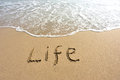 Word life drawn on the beach and sea wate Stock Photography