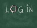 The word login with gear wheel on chalkboard
