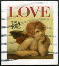 Word love and Cherub from Sistine Madonna Stock Photography