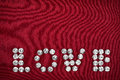 The word love made by ​​with rhinestones can be used as background Royalty Free Stock Photos