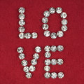 The word love made by ​​with rhinestones can be used as background Royalty Free Stock Photography