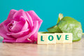 The word love and pink roses on table Royalty Free Stock Photo