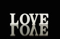 Word love, wooden letters on black background Royalty Free Stock Photo