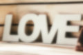 Word Love on wooden planks background.blurred image