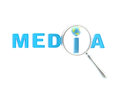 Word media under the magnifier isolated Royalty Free Stock Image