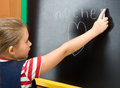 Word mom schoolgirl writing on the chalkboard Stock Photos