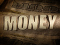 The word money on paper background in cut out letters Stock Photos