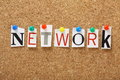The word network in magazine letters on a cork notice board a may be a community of friends or colleagues but also applies to Royalty Free Stock Photos