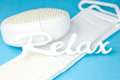 Word relax on sponge and scrubber stock photo bathroom or sauna decoration in white in turquoise Royalty Free Stock Photos