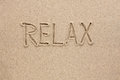Word relax written sand as background Stock Photos