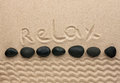 The word relax written on the sand as background Royalty Free Stock Photo