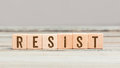 Word Resist on six wood cubes