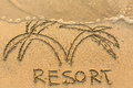 Word Resort and palm trees - drawn by hand on a light-golden beach Royalty Free Stock Photo