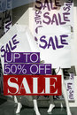 The word Sale on paper bags in shopping window Stock Photo