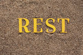Word on the sand laid out rest Stock Image