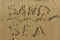 Word of sand sea written on the sand can be used as background Royalty Free Stock Photos