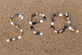 Word sea made of shells and pebbles on the sand Royalty Free Stock Photo