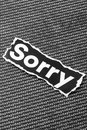 The word sorry a closeup of torn printed on a background of today Royalty Free Stock Image