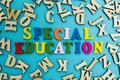The word `special education` is laid out from multicolored letters on a blue background