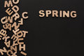 Word Spring with heap of wooden letters