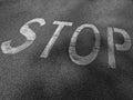 Word stop painted on asphalt Stock Image