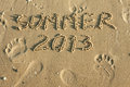 Word summer written by in the sand Royalty Free Stock Photo