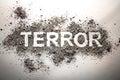 The word terror written in ash as terrorism, war, death, murder, Royalty Free Stock Photo