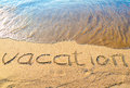 Word vacation written wet sand sea Royalty Free Stock Photos