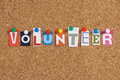 The word volunteer in cut out magazine letters pinned to a cork notice board Stock Images