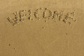 Word welcome written on the sand Stock Images