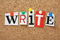 The word write in cut out magazine letters pinned to a cork notice board Royalty Free Stock Image