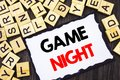 Word, writing, text Game Night. Business concept for Entertainment Fun Play Time Event For Gaming written on Skicky Note Paper on
