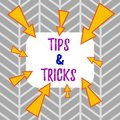 Word writing text Tips And Tricks. Business concept for Steps Lifehacks Handy advice Recommendations Skills Asymmetrical Royalty Free Stock Photo