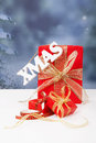 The word xmas hanging over red christmas presents present Stock Image