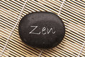 Word zen written on a black stone Royalty Free Stock Photo