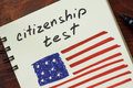 Words  citizenship test and American flag. Royalty Free Stock Photo