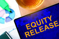 Words equity release on the tablet and charts business concept Royalty Free Stock Image