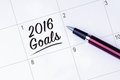 The words goals on a calendar planner to remind you an impo important appointment with pen isolated white background new year Royalty Free Stock Images
