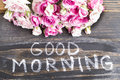 Words Good Morning with Pink Roses on a Rustic Wooden Background Royalty Free Stock Photo