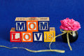 The words mom love spelled with alphabet blocks Royalty Free Stock Photo