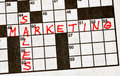 The Words Sales and Marketing on Crossword Puzzle Royalty Free Stock Photos